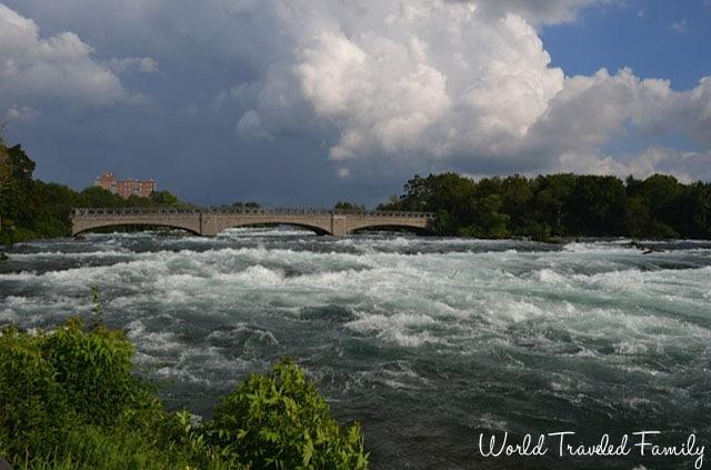 view of stone bridge that crosses the Niagara River just before the Horseshoe Falls