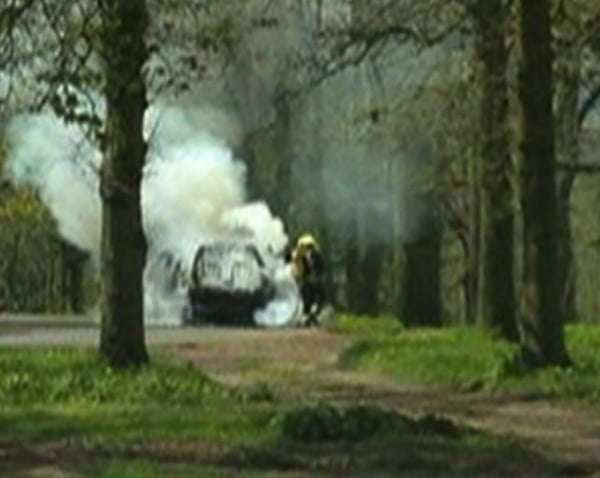 Helen Clements Car on fire in the Lion Enclosure at  Longleat Safari Park