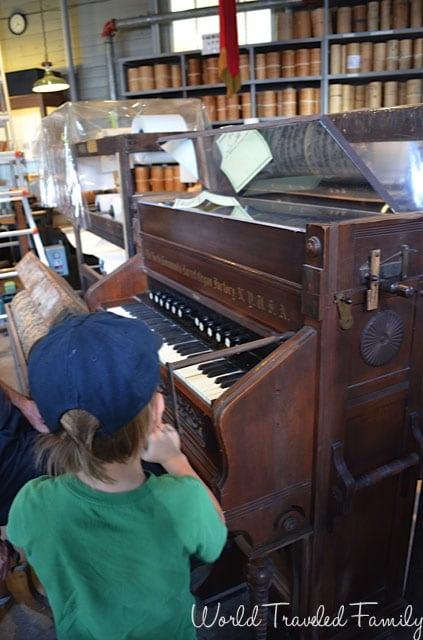 Allan Herschell Carrousel Factory Museum - playing the parlor organ